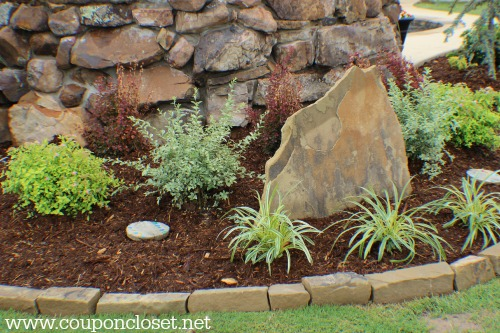 how we saved so much money on our landscaping- buy real rocks